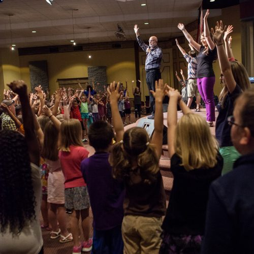 Vocal Coach Chris Beatty Teaching Kids hands up